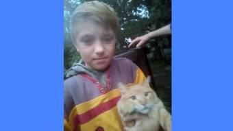 Назар Бутенко рятує кішку